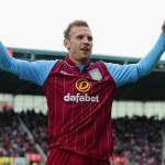 © Getty Images / Weimann raises his arms towards the fans as he waits for his team mates to come over and congratulate him...