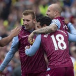 © Aston Villa FC via Getty Images / Kieran Richardson and Alan Hutton get to the goalscorer first to give him a warm embrace behind the Stoke goal