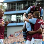 Elated: Villa players flock to Weimann after they took total control of the match at 2-0